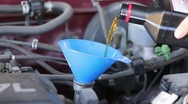 Stock Video Footage of Motor oil poured into funnel