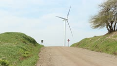 Windmill and a country road Stock Footage