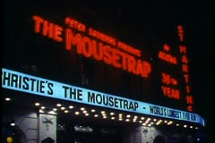 "London,  at Night, wide shot of ""The Mousetrap"" theatre, sign, marquee Stock Footage"