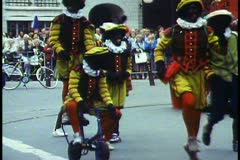 Amsterdam, Flower Parade, blackface elves dancing, medium shot Stock Footage