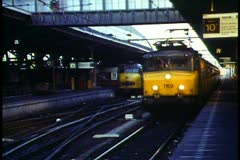 Amsterdam,  Train, yellow, leaving the station, from the platform Stock Footage