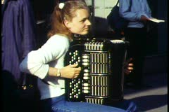 Copenhagen,  Street entertainer, young woman accordion player Stock Footage