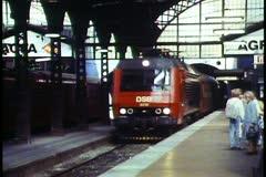 Copenhagen, Train leaves Copenhagen station, passing out of station Stock Footage