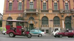 Chinese traffic in front of a Russian style building Stock Footage