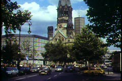 Berlin, Germany, Kaiser Wilhelm Memorial Church on Ku-dam, traffic - stock footage