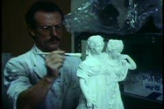 Berlin, Germany, State Plasterworks, man works on two plaster figures - stock footage