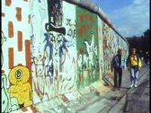 Berlin,  The Berlin Wall in 1988, people walk alongside, graffiti Stock Footage