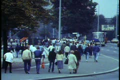 East Berlin,  1988, crowd on sidewalk, medium wide shot, walking 3 shots - stock footage