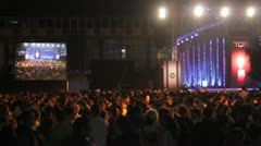 546 high angle shot of huge Crowd at a night assemly Stock Footage