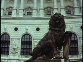 Stock Video Footage of Vienna,  The Hofburg, medium shot, lion and neoclassic facade, tilt up