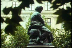 Vienna,  Great Viennese composer statues, Beethoven, framed in trees - stock footage