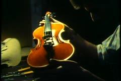 Vienna,  String instrument manufacturing, man examines violin Stock Footage