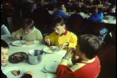 Vienna, Vienna Choir Boys, boys eating in communal dining hall Stock Footage