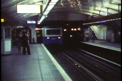 Paris,  Metro, train into station arriving from left, wide shot Stock Footage