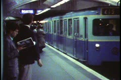 Paris,  Metro, train into station wide shot, crowd boards train - stock footage