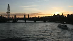 Hungerford bridge in London at sunset Stock Footage
