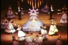 Paris, The Folies Bergere show  medium shot, colorful dancers Stock Footage