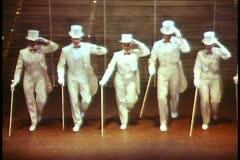 Paris, The Folies Bergere show  medium, white top hat dancers harlequin Stock Footage
