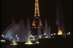 Paris, Paris by night, floodlit Eiffel Tower, fountains, full moon Stock Footage