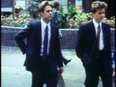 London,   Crowd walking, two young bankers in suits, crushed Stock Footage