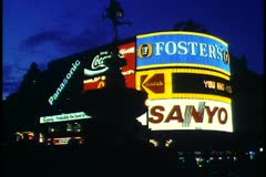 London,  at Night, Piccadilly Circus, wide shot, neon and deep blue sky Stock Footage
