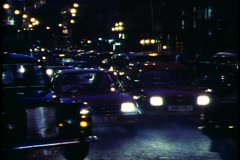 London,  at Night, crushed shot of traffic and taxis, headlights - stock footage