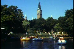 Copenhagen,  Tivoli Gardens, wide shot, lake, boats, tower in background Stock Footage