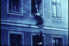 Berlin,  B&W Archival, 1961, old women lowered out, jumps, dramatic Stock Footage