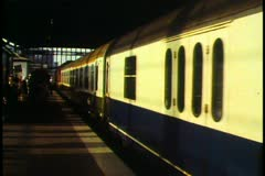 Berlin, Germany, Train leaving Berlin station, under shed, wide shot Stock Footage