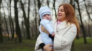 Mother and Baby in Park Stock Footage