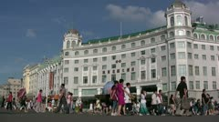 Chinese tourists walk past a Soviet style building in Harbin Stock Footage