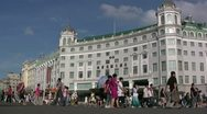 Stock Video Footage of Chinese tourists walk past a Soviet style building in Harbin