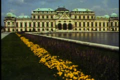 Vienna,  Belvedere Palace, wide shot, flowers in foreground, tilt up - stock footage