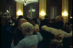 Vienna,  Waltzing, large group on dance floor, waiter carries tray through Stock Footage