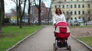 Mother WIth Baby Pram in Park Stock Footage
