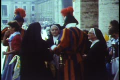 Rome, The Vatican, Papal Mass, Swiss Guards direct nuns - stock footage