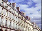 Stock Video Footage of Paris,  Rue du Rivoli, wide shot of arcade, traffic in front, busy