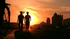 China streets, sunset silhouettes, young men walking, friends, colorful, Chinese Stock Footage