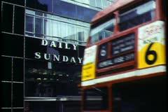 London,   Fleet Street, double decker bus passes Daily Express bldg. Stock Footage