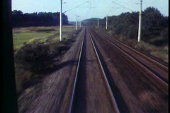 POV from rear of train, shot in Germany, retreating tracks, fast Stock Footage