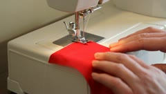 sewing on sewing machine - stock footage