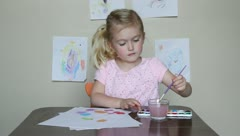 Preschooler painting with watercolors - stock footage