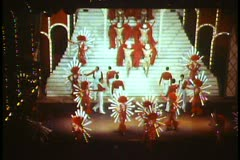 Paris, The Folies Bergere show  wide shot, dancers in red, lively Stock Footage