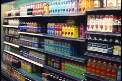 Stock Video Footage of Berlin, Germany, Europa Center, interior, supermarket aisle, bottles