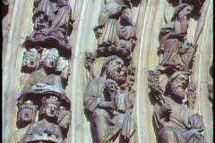 Paris,  Notre Dame, close up hundreds of statues, follow pan right and up Stock Footage
