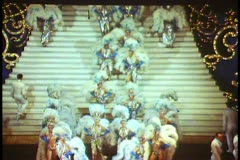 Paris, The Folies Bergere show  wide shot, blue and white boas Stock Footage
