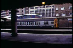London,   British Rail train leaving the station, wide distant shot Stock Footage