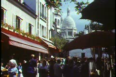 Paris,  Place du Tertre, busy, cafe and artists, domes of Sacre Couer Stock Footage
