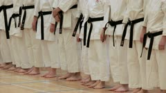 blackbelts at a karate competition - stock footage