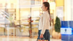 Two sisters met at the mall holding hands and they are looking at camera Stock Footage